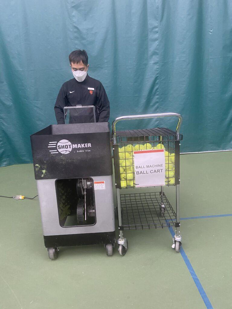 Coach Ramon with the tennis ball machine